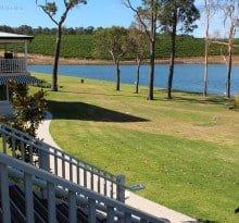 View of the lake and grape vines at Aravina Estate