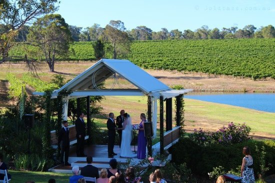 Bride and Groom getting married on the lawn at Aravina Estate