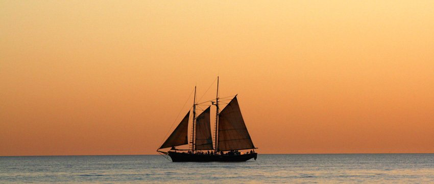 Willie Pearl Lugger sailing into he sunset in Broome WA