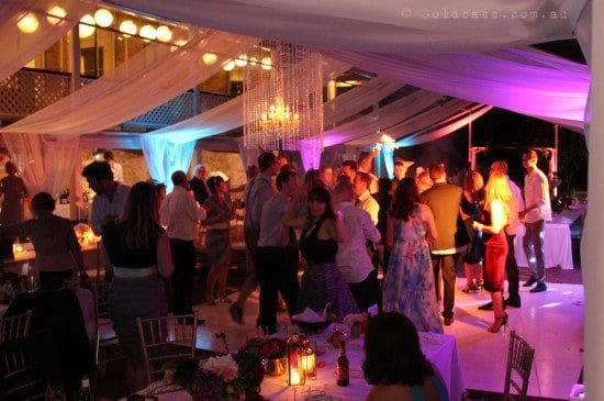 Wedding Guests Dancing Under Colourful Marquee