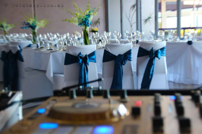 Wedding tables and Gold Pioneer DJ Setup at Portofinos