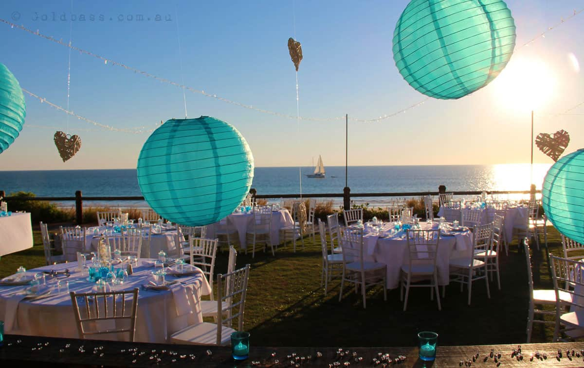 Photo Of Cable Beach Ocean With Boat Cruising Past At Wedding Reception Setup