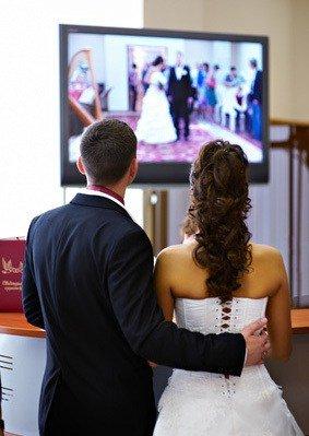 Bride and Groom Watching Video